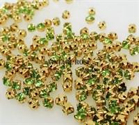 Стразы в цапах, 4мм, св. зеленый, в золоте