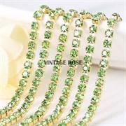 Лента из страз в золоте 2 мм, Светло-зеленая